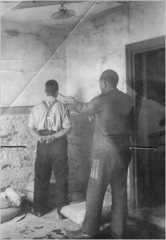 A Mauthausen block leader punishes an inmate