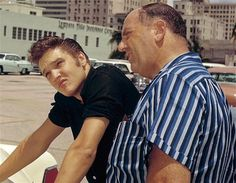Elvis buying his white Continental in Tampa in august 4 1956. Here with his manager , Colonel Tom Parker.
