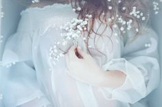 Elisa Imperi's Ophelia inspired photo shoot is hauntingly beautiful. Featuring baby's breath flowers, a bathtub, and a stunning hazy effect, this series is sure to inspire you!