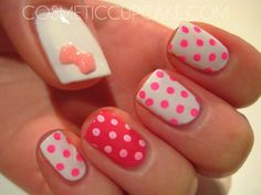 Cute polka dots nails with a bow!