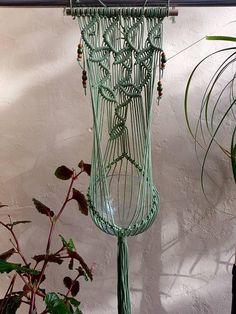 This is my signature design Macrame Plant Hanger/Fruit Bowl Hanger featuring a leaf pattern using cotton cord, which I have hand dyed to what I like to call moss green, however I do custom make colours so please start a conversation with me if you would like this design in your
