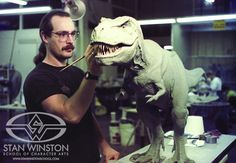 """Mike Trcic, a """"Jurassic Park"""" (1993) sculptor, adds final changes to the one-fifth scale T-rex clay model. http://news.cnet.com/2300-17938_105-10016367-2.html"""