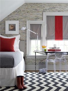 Awash in classic colors and fresh pattern. A balanced and beautiful bedroom that uses classic and key design elements: black and white area rug for warmth underfoot, task lamp that acts as a reading light in bed or desk lamp by day and roman shades that tie together the rich red and cool gray colors found in the bed linens.