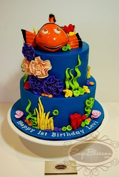 Finding Nemo Birthday Cake - I made this cake for a 1st birthday.  White Choc Mud with Dark Choc Ganache and Dark Choc Mud with White Chocolate Ganache.  All decorations are 100% edible inclusive of Nemo - he is made from a combo of gumpaste and fondant.