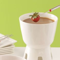 Butterscotch Fondue Recipe  ~~  1/2 cup packed brown sugar, 1/2 cup light corn syrup, 1/4 cup heavy whipping cream, 2 tblsp butter or margarine, 1/2 tsp vanilla extract and fresh fruit