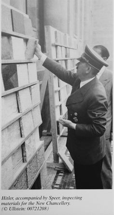 Hitler, accompanied by Speer, inspecting materials for the New Chancellery.