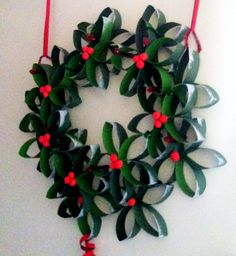 Xmas Wreath: toilet paper rolls + green and red pipe cleaners + glue + salt dough for holly berries + acrylic paint (green/red/white)