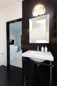 Silver Framed Bathroom Mirrors brighten up the bathroom with a pop of bright color and some