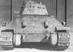 Detailed photo of a German modified T-34/76 tank showing the rear deck and exhaust components on the captured Beute Panzer