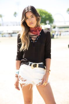Jill Wallace works the Coachella festival grounds in a flirty black H&M lace-up top.