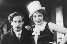 """Josef von Sternberg and Marlene on the set of """"The Blue Angel."""" The white top hat was her idea, a look from her cabaret act."""
