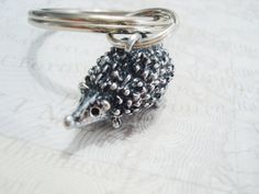 Items similar to HEDGEHOG KEYCHAIN personalized with initial charm - silver hedgehog backpack charm, keychain, purse charm or zipper pull - see all pix on Etsy Charmed Show, Initial Charm, Special Gifts, Hand Stamped, Initials, Silver Rings, Zipper, 3d, Purses