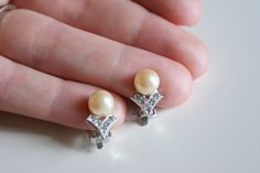Vintage Pearlescent Bead and White Rhinestone Clip Earrings. $10.00, via Etsy.