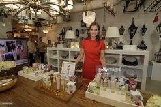 Aerin Lauder, Founder and Creative Director of AERIN, stands in front of a display of her products as she visits Circa Lighting Showroom on December 3, 2014 in Houston, Texas.