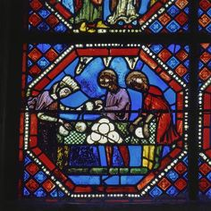 Cathédrale Saint-Etienne de Bourges. Lancette de la chapelle sainte Solange vitrail de saint Jean l'Evangéliste (détail) , le travail des boulangers, donateurs. La cathédrale Saint-Étienne de Bourges, construite entre la fin du XIIe et la fin du XIIIe siècle. Elle possède des vitraux du XIIIe jusqu'au XVIIe siècle. PÉRIODE 13e siècle TECHNIQUE/MATIÈRE vitrail (technique)