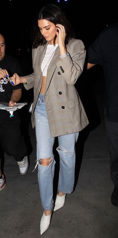 Kendall Jenner's Best Style Moments via @WhoWhatWearAU | Kendall in long blazer, blue jeans and white pointed boots