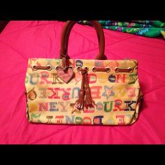 Dooney and Bourke handbag Colorful classic bag. Bottom inside is worn out. Dooney & Bourke Bags Mini Bags