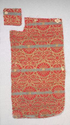 Date:      14th century  Geography:      Made in, Lucca, Italy  Culture:      Italian  Medium:      Silk, metal thread  Dimensions:      Overall: 20 x 10 1/2 in. (50.8 x 26.7 cm)  Classification:      Textiles-Woven  Credit Line:      Fletcher Fund, 1946  Accession Number:      46.156.29