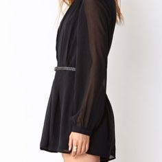 Black Top with Sheer Sleeves NWOT- Black tunic with sheer wide sleeves | First Pic is not actual item, closest pic I could find to model/style  Tops Tees - Long Sleeve