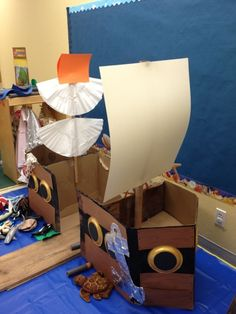 The children painted the ship black and brown and they also painted the port holes gold, I assembled the ship. Each classroom was challenge...