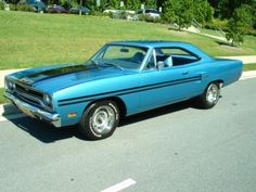 Reminds Me Of My Dad's Numbers Matching 1970 B5 Blue GTX, Original 440 Magnum With The 4-Speed and Console. Matching Blue Interior, With The Original Ralleye Rims. One Very Outstanding Piece Of Mopar Muscle, Nothing Quite Like The Looks Of A 1970 GTX!
