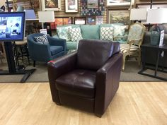 FIND FURNITURE, DECOR AND MORE, FOR LESS AT NEW USES: Very Comfy Brown Vinyl Club Chair that is very heavy and built to last $100.