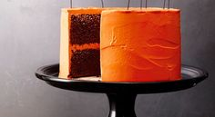 Chocolate Pumpkin Cake- This stunningly spooky cake makes a delicious Halloween dessert, but is also pretty enough to serve as your party table's centerpiece. Get more dessert ideas at Redbookmag.com.