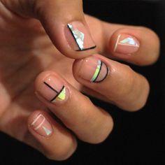 Minimal negative space nail art design