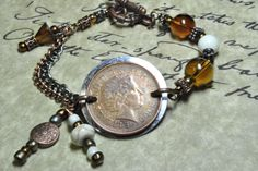 2 Pence UK coin bracelet.  Amber glass and Howlite beads. Gunmetal and Copper color chain with toggle clasp.