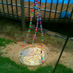 Homemade bird feeder. Embroidery hoop, wire, beads, and screen. Found instructions in my moms Birds And Blooms magazine, but easy to do without instructions.