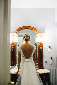 Backless Lace Novia d'Art Bridal  Gown & Detachable Train | Chic Chignon Up Do | Italian Destination Wedding | Peach Colour Scheme | Stefano Santucci Photography | http://www.rockmywedding.co.uk/celine-roberto/