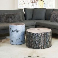eclectic ottomans & cubes by Huset - Krone Hanssen Wood Stubbe Poufs - $260.00 » These stumps may look like the real thing, but they are much more comfortable! Made from recycled materials and covered with photographic prints, these versatile poufs from Norwegian brand Krone Hanssen can be used as side tables or extra seating.