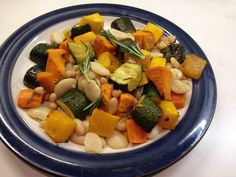 Mixed roast veg (sweet potato, squash, carrots and courgettes), roasted in rosemary with pinto and cannelloni beans.