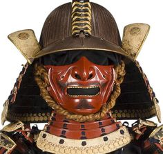 sixty-two plate suji kabuto signed Joshu ju Saotome Ienori, mabizashi and fukigaeshi with gilt-copper fukurin carved with floral scroll, five lame shikoro, lacquered wood horseshoe crab tail maedate, menpo with standing flanges on the cheeks and gilt-metal teeth.