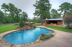 """View this Great Rustic Swimming Pool with Outdoor kitchen & exterior stone floors in Willis, TX. The home was built in 1990 and is 3806 square feet. Discover & browse thousands of other home design ideas on Zillow Digs. Backyard Pool Landscaping, Swimming Pools Backyard, Swimming Pool Designs, Modern Landscaping, Landscaping Ideas, Backyard Ideas, Outdoor Ideas, Garden Ideas, Jacuzzi"
