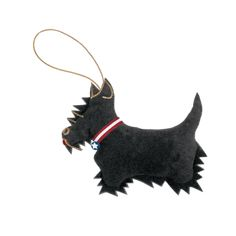 """The inseparable companion of President Franklin D. Roosevelt, Fala, the Scottish Terrier, was a nationally adored resident of the White House during his master's administration. """"FALA"""" is written in gold thread on the back of this new ornament. Felt, with gold loop.<br /> <br /> <p><span style=""""color: #ff0000;""""><..."""