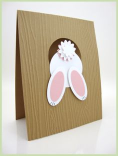 Stampin' Up! ... hand crafted Easter card ... punch art bunny escaping through the bunny hone in wood grain embossed card ... cute tail ...