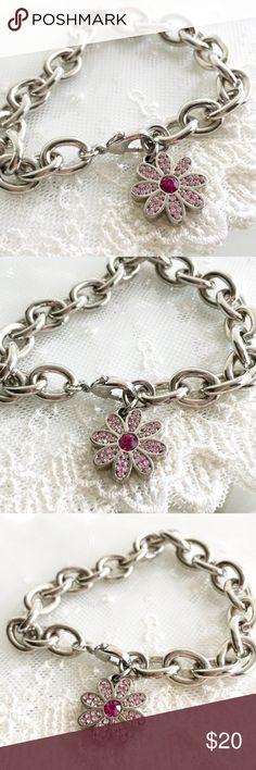 """Coach Pave Multi Pink Crystal Daisy Bracelet 🎀NOTE TO BUYERS... all my items are marked to lowest price. PLEASE DON'T MAKE OFFERS, MY PRICE IS FIRM. Thank you and have a Wonderful Day!🎀  100% Guaranteed Authentic Coach Multi Pink Pave Daisy charm on CUSTOM silver with rhodium finish (will not lose shine and resists tarnishing) link 8"""" bracelet with lobster closure clasp. No box.   I can adjust to ANY SIZE needed.... Just ask. Chunkier style bracelet  Take a peek at my other listings for…"""
