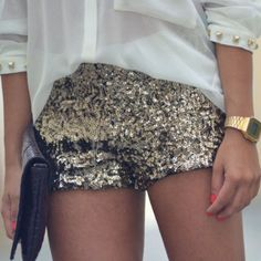 gold sequin shorts and sheer blouse