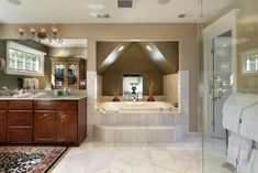 Yikes - this bathroom is bigger than apartments I've lived in. Check out that bathing alcove.  This is some serious luxury - like a spa.