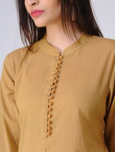 Olive Pleated Cotton Mul Kurta with Potli Buttons Olive Pleated Cotton Mul Kurta with Potli Buttons Chudi Neck Designs, Neck Designs For Suits, Sleeves Designs For Dresses, Neckline Designs, Dress Neck Designs, Sleeve Designs, Kurtha Designs, Blouse Designs, Churidar Neck Designs