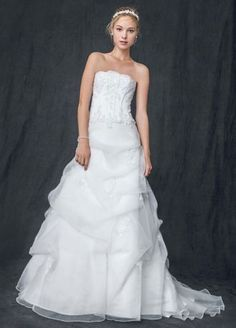 Organzacorset ball gown with beaded lace appliques, organza pick-up skirt, and lace-up back. Chapel train. Sample Sale gowns are only available online (not available in stores). Sample Sale g