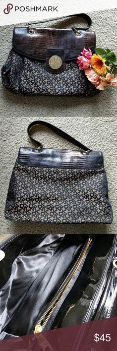 DKNY Black and Brown Shoulder Bag Large size. Interior is in excellent condition. Bottom has minor scratches - see photos. DKNYC Bags