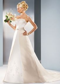 Simple elegance in a flattering silhouette.   Satin A-line gown features split front skirt with gathered waist.  Beautifully beaded lace accents the strapless scalloped bodice and skirt.  Chapel train.  Ivory/Champagne available online.  Fully lined. Back zip. Imported polyester. Dry clean only.   To preserve your wedding dreams, try our Wedding Gown Preservation Kit.