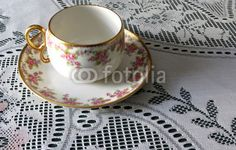 Limoges China Cup and Saucer on Lace Tablecloth