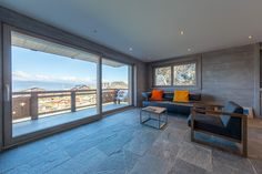 """Magnificent View on Swiss Alps from that Wonderful Living Room. Located in the Brand New """"Mer de Glace"""" Complex in Nendaz. Learn more about it on our Website ! Swiss Alps, Switzerland, Apartments, Real Estate, The Incredibles, Windows, Patio, Mountains, Living Room"""