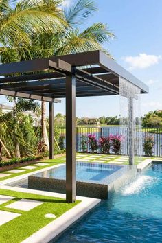 A nice swimming pool with water feature can also work with other landscaping ideas, such as a decking area with lounge chairs – or a full outdoor living room – attached to the pool area.
