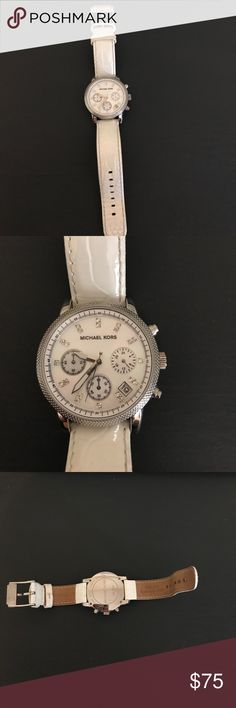 Michael Kors white leather watch Michael Kors white leather watch. Worn once. Needs battery. Rhinestone details on watch surface. Beautiful piece but I don't wear silver anymore. Michael Kors Jewelry