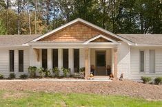 Combination bracket and column portico across a ranch home. Designed and built by Georgia Front Porch.