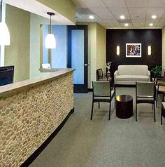 Java Tan pebble tile for the reception desk -  I like the idea of adding an extra texture to the waiting room. This could really enhance the desk